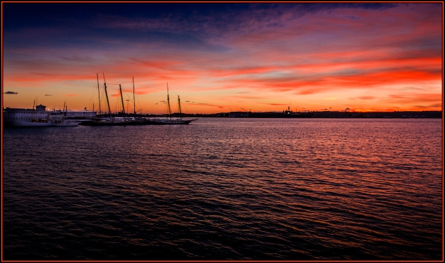 Sunset over San Diego Bay.  Shot from the waterfront near the Maritime Museum.  Canon 5D MkII w/ 17-40mm f4L @ about 30mm.