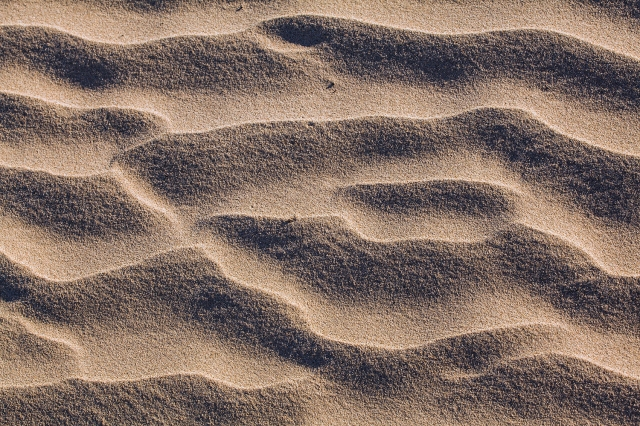 The wind may feel like a smooth flow of air, but within that flow are all of the small variations that can create this intricate pattern in the sand.  Canon 5D MkII w/ 70-200mm f4L