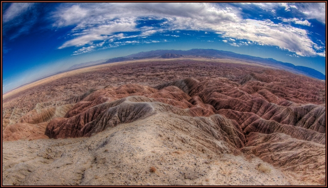 Full-frame fisheye view of Vista del Malpais.  A trail leads from this overlook down into the badlands but one slip and you would fall and roll down hundreds of feet of rocks to the bottom.  Canon 5D MkII w/ 8-15mm set at 15mm.