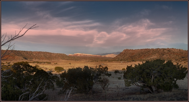 Dawn view of the Galisteo Basin and bluffs with many Indian ruins.  Click on image to see an enlarged version.