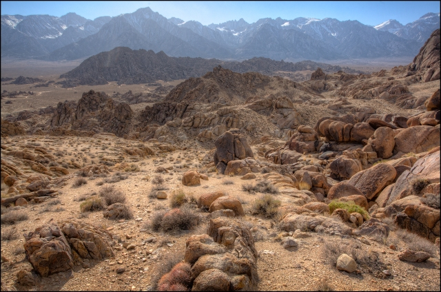 Looking west from a high ridge overlooking the Alabama Hills.  In the distance are the Sierras with Jagged Mt. Whitney and also Mt. Lone Pine.  Click on the image to see it enlarged.