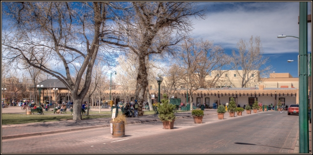 Looking across the Plaza Square to the Portal of the museum in Santa Fe.  If you look close you can see the Indian vendors under the portal.  That place has been set aside for Native American craftsmen to sell their wares.  Click om image to enlarge.