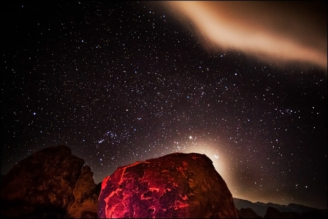 """Stars and cloud.  The glow behind the rock is the moon.  THe red """"lava"""" look to the rock is the result of a color balance mismatch.  I set the balance to daylight since we were going to paint the rocks with LED lights but a car's headlights did the job here."""