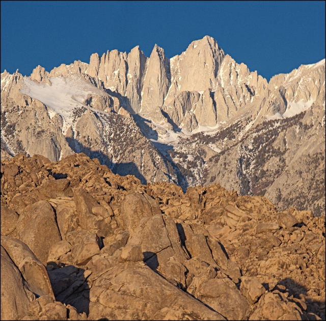 Golden Dawn light on Mt. Whitney towering above the Alabama Hills.