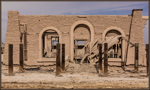 Main entrance to a now abandoned resort near the Salton Sea.  Once a show piece for visitors to the area it now lies in ruins, the adobe walls slowly going back to the earth.