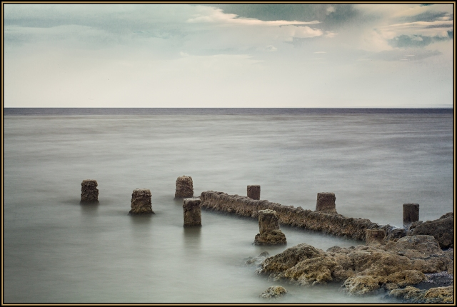 A 20-second exposure turned the choppy water into a somewhat surreal fog-like area as the water lapped against and around the old pilings.