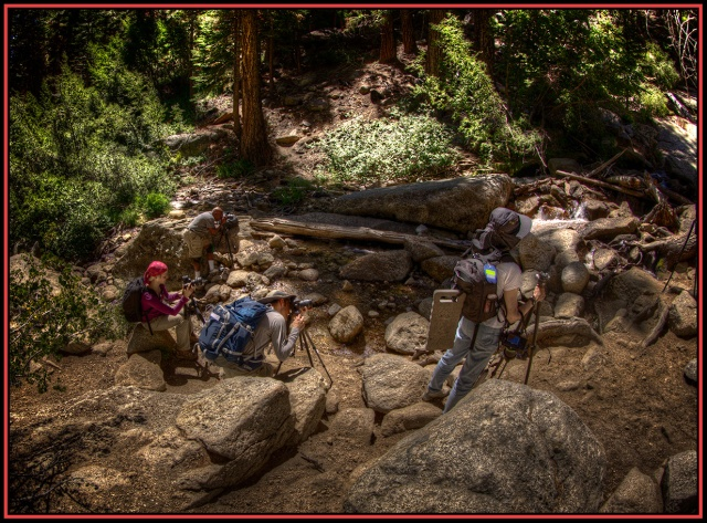 Workshop participants scramble for a point of view at the base of the waterfall at the  Whitney Portal trailhead.