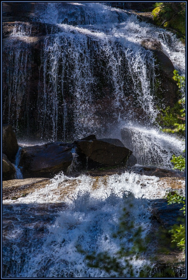 """A shutter speed of 1/4000 of a second catches the sparkle of the splashing water cascading down the rocks of what the USGS map calls a """"rapids."""""""
