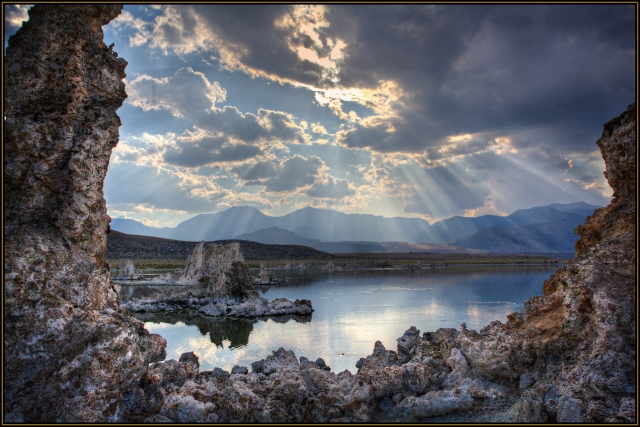 Late afternoon light streaking through the clouds over Mono Lake and its famous tufa towers.