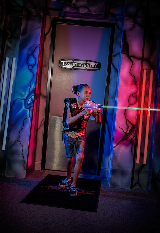 A fearson laser warrior advances on the unseen targets in a lasertag arena.  Shot with Canon 5D MkIII, 24-105mm lens at 35mm.