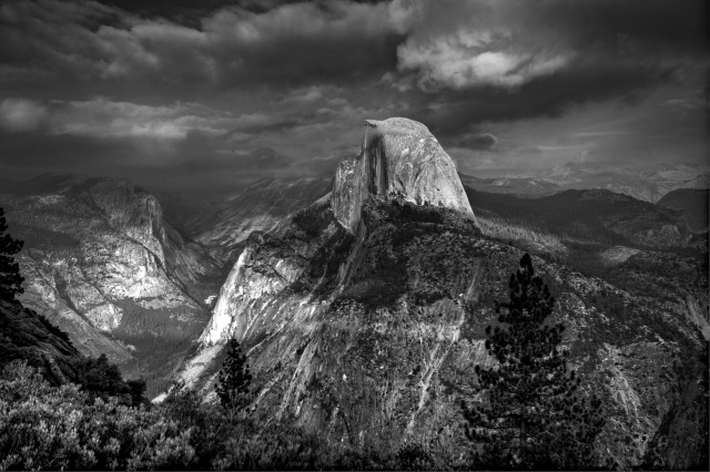 "THe clouds formed a giant ""cookie"" (a lighting term) letting a spot hit this iconic rock form.  It was so spectacular it screamed for a more traditional black and white treatment."