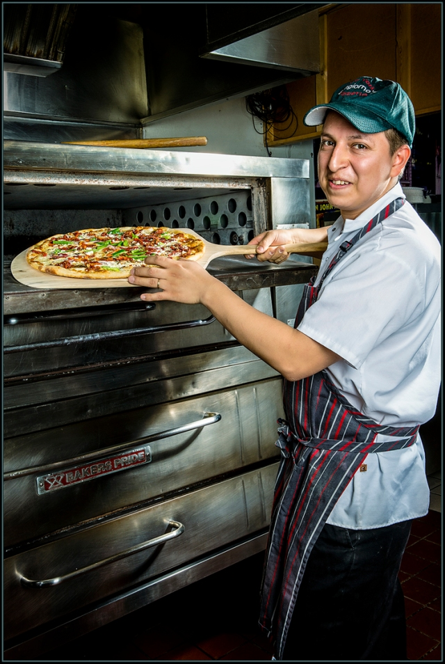 Owner of Bongiorno Pizza in Poway removes a newly baked pizza from his oven.  Canon 5D Mark III with Canon 24-70 L