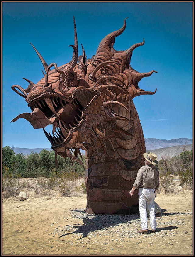 A photo of David examining the incredible Sea Serpent sculpture in the Galleta Meadows near Borrego Springs, CA.