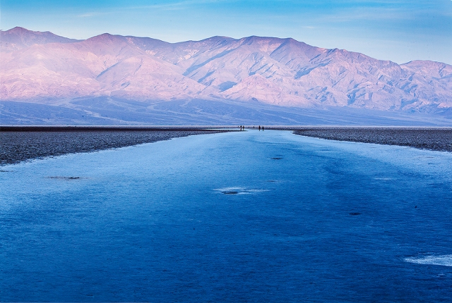 It looks like ice, but is actually salt polished by people walking on it at Badwater, Death Valley.
