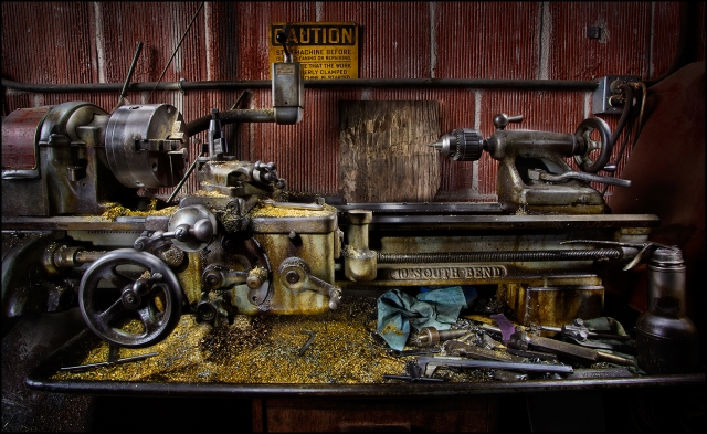 An old lathe at the Transportation Museum in Campo, CA.  Shot with Canon 5D MkII and Canon 17-40mm f4L.  This shot was made with a Painting With Light approach from 41 separate exposures, each lighting a small area of the subject.  You can click on the image to enlarge it.