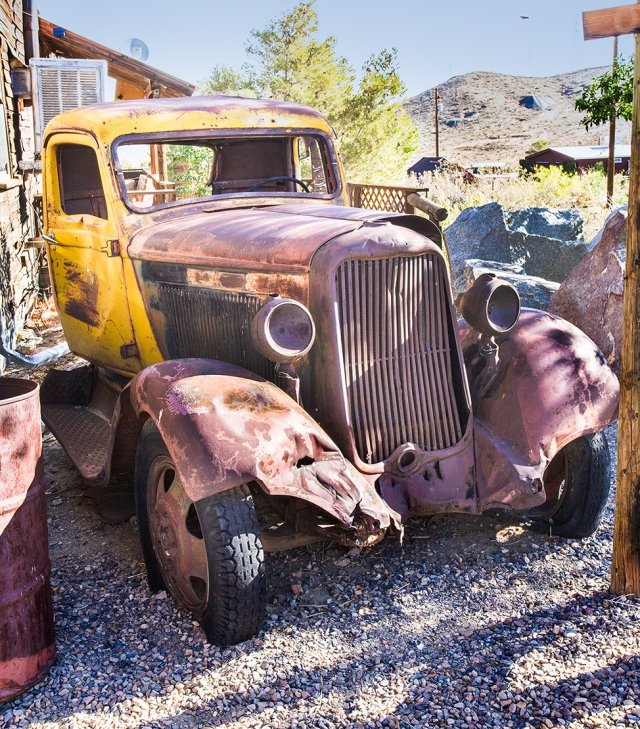"Old truck next to a saloon and ""Floozy House"" in Randsburg."
