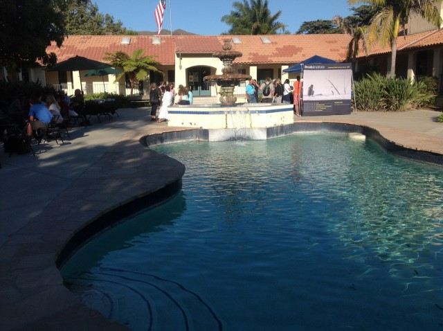 The participants in the Brooks Teachers Conference for 2014 start to gather around the fountain and pool.  iPad Photo