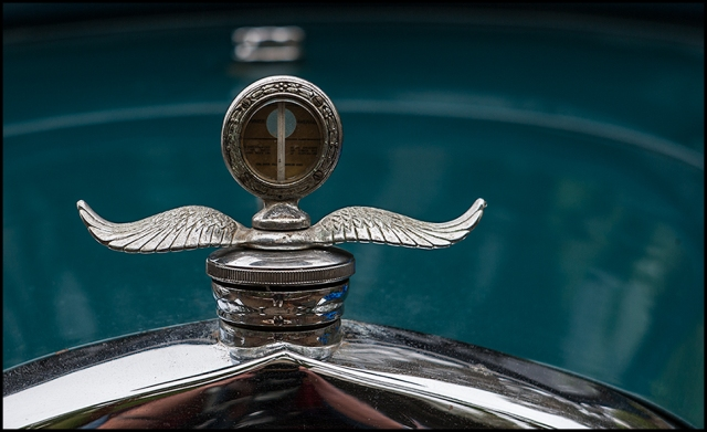 Classic Ford radiator cap on Coup saved from the fire