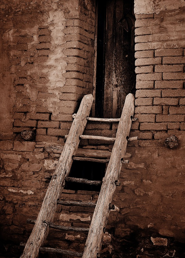 """A pueblo """"walkup"""" entrance and door."""