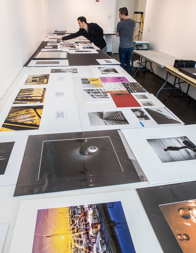 Gary (front) and Kent looking at one of the categories of prints to jury for the 2015 City College Student Show.