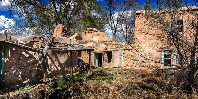 An abandoned adobe house is Taos, NM, slowly melts back into the earth.  anon 5D Mk II.