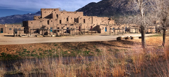 Pueblo apartments sit on plaza across from the Acequia in Taos Pueblo at the base of their sacred Taos Mountain.  Canon 5D MkII