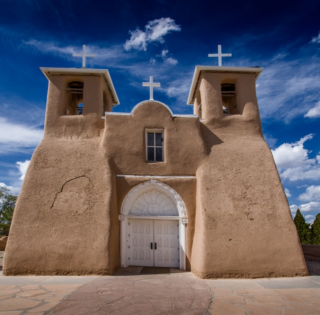 The seldom photographed front of the famous St. Francis de ASis mission in Taos, NM.  Canon 5D Mk II.