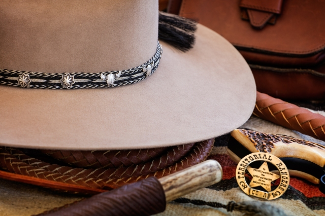 Custom Hat by O'Farrell in Santa Fe showing the  custom hat band by Jim Neely, Santa Fe.  Shot with Canon 5D SR and Canon 70--200 f4 lens.  Click on the image to enlarge.