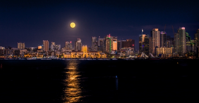 A wider view of the supermoon rising over the San Diego waterfront.