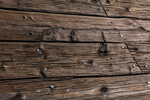 Well worn and weathered planking on the Morro Bay pier