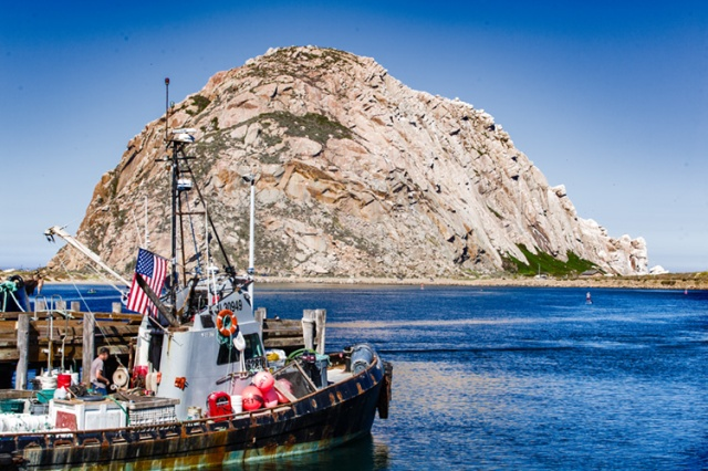 Fishing boat in Morro Bay in front of Morro Rock