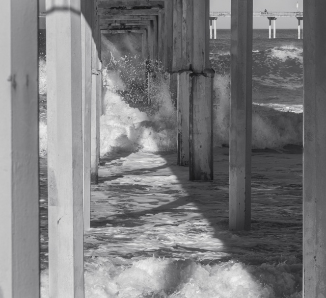 """Looking down through the pilings you can see that """"tunnel"""" is filled with churning water. It was through that maelstrom that the surfer tried to shoot the pier. Brilliant... Not..."""