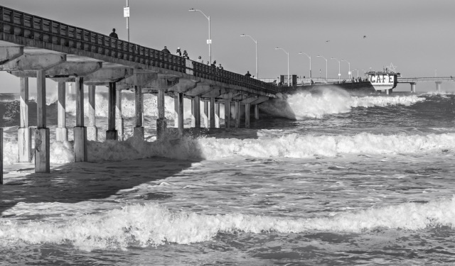 As the huge volumes of water in a wave is forced under the pier it squirts out in a powerful spray.
